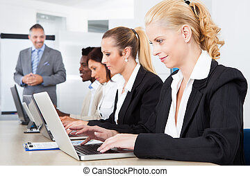 Group Of Businesspeople Working Together - Group Of Multi...