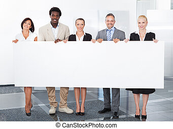Multiracial Businesspeople Holding Placard - Group Of Happy...