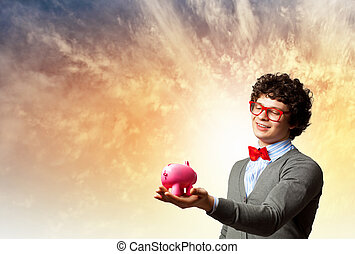 Young businessman holding moneybox - Image of young...