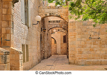 Narrow street and stonrd houses at jewish quarter in...
