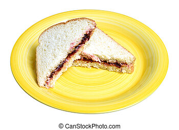 peanut butter and jelly sandwich on a yellow plate