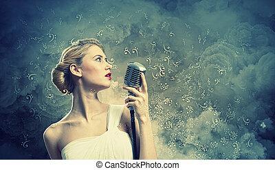 Female blonde singer - Image of female blonde singer holding...