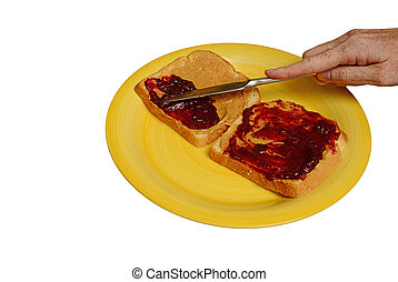 making a peanut butter and jelly sandwich on white