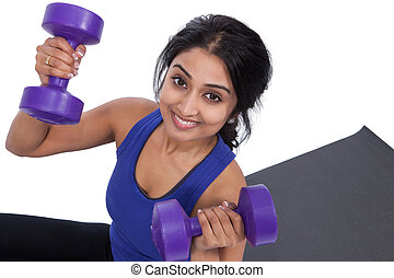 Young female with dumbells - Smiling Asian female holding...