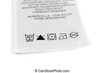 Laundry care symbols. - Close up view on an isolated washing...
