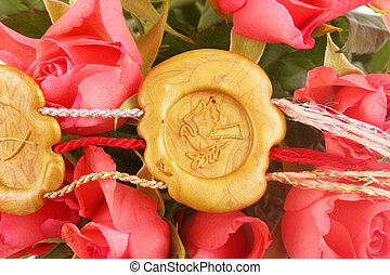 seal - A golden seal with a dove symbol on roses