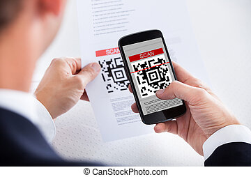 Businessman Scanning A Barcode - Close-up Of Businessman...