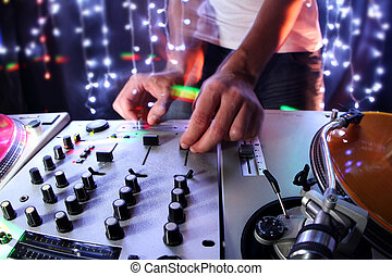 cool dj - a cool male dj on the turntables