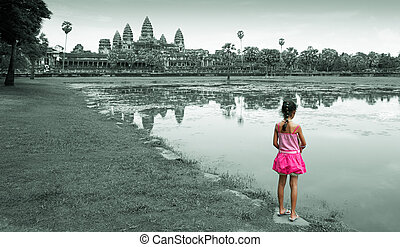 angkor wat - little girl standing at the lake side