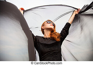Redhead girl with cloth