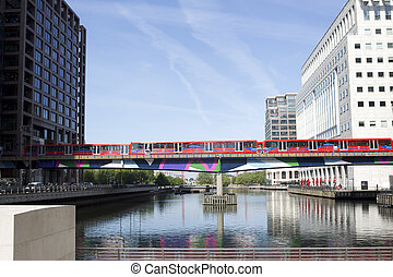 docklands bridge - brigde with train shot in london's canary...