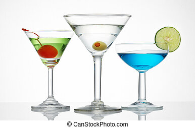 alcohol line up - three glass of alcohol drinks against...