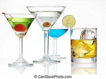 alcohol line up - four glass of alcohol, shallow depth of...
