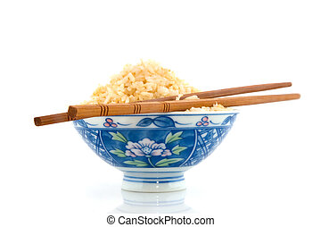 brown rice with chop sticks