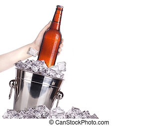 frosty beer with ice bucket and hand isolated on a white...