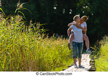Piggyback - Lovely lesbian couple are piggyback together,...