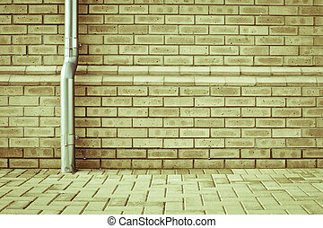 Drainpipe - A metal drainpipe against a modern brick wall as...