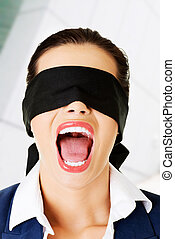 Beautiful frighten young blindfold woman
