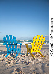 Beach wooden chairs for vacations and summer getaways in...