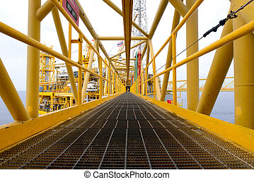 the pathway bridge of offshore oil rig - the worker is...
