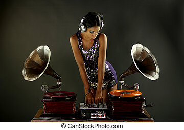 gramophone dj - sexy young woman djs using two retro antique...