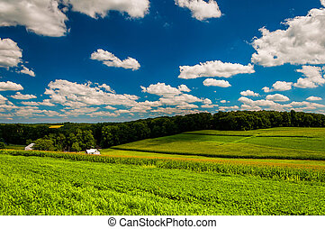 Clouds over farm fields in rural Southern York County, Pennsylvania.