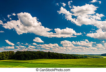 Summer clouds over fields  and hills in rural York County, Pennsylvania.
