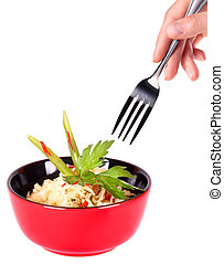 Healthy Chinese food in a red plate and hand with fork...