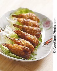 vegetarian mock chicken drumsticks - close up of vegetarian...