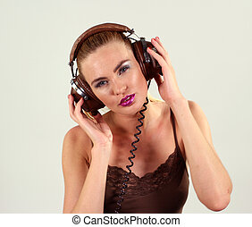 headphone girl - sexy woman listening to music on headphones