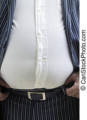 Stomach bursting shirt - Overweight man pulling-up his belt.