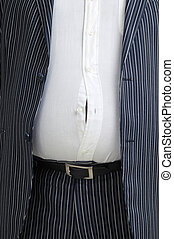 Shirt button popping - Man in suit with a button popped on...