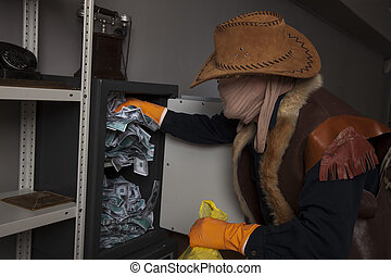 A thief steals money from the safe