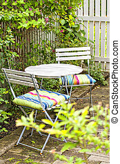 Garden seating area - Image of cozy seating area in lush...