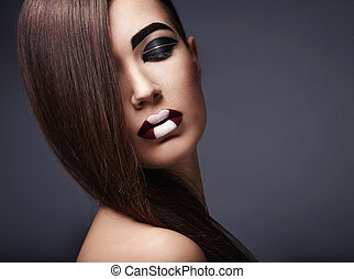 Hairstyle - Beautiful young girl with make-up on black...
