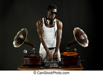 gramophone dj - cool young man djs using two retro antique...