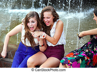 Beautiful girls having fun with a fountain