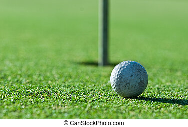 Old Golf Ball - a close up of an old scuffed up golf ball on...