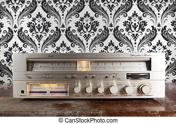 radio receiver against retro wallpaper
