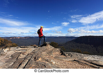 Bushwalker admiring the view from Flat Rock Wentworth Falls...