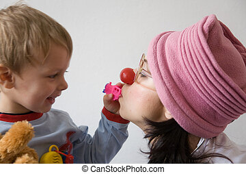 Clown doctor - Clown-doctor : boy is playing with red nose...