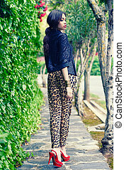 Beautiful woman, model of fashion, wearing leopard pants -...