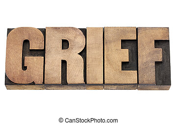 grief word in wood type - grief word - isolated text in...