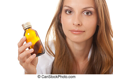 woman doctor with medication in glass bottles - woman doctor...