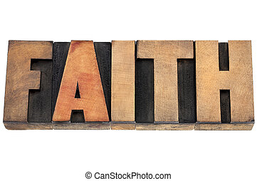 faith word in wood type - faith word - isolated text in...