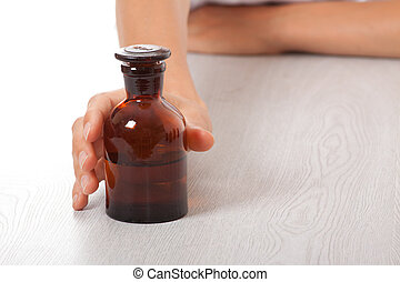 hand with small bottle