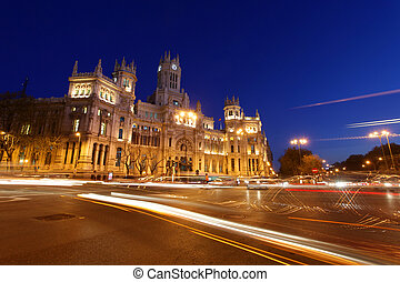 plaza de cibeles - rush of night time traffic at plaza de...