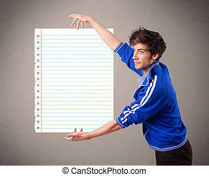 Young man holding white paper copy space with diagonal lines...