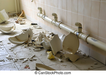 destroyed toilets in a disused factory