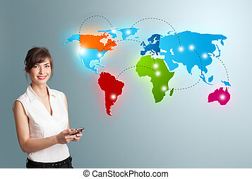 Young woman holding a phone and presenting colorful world...
